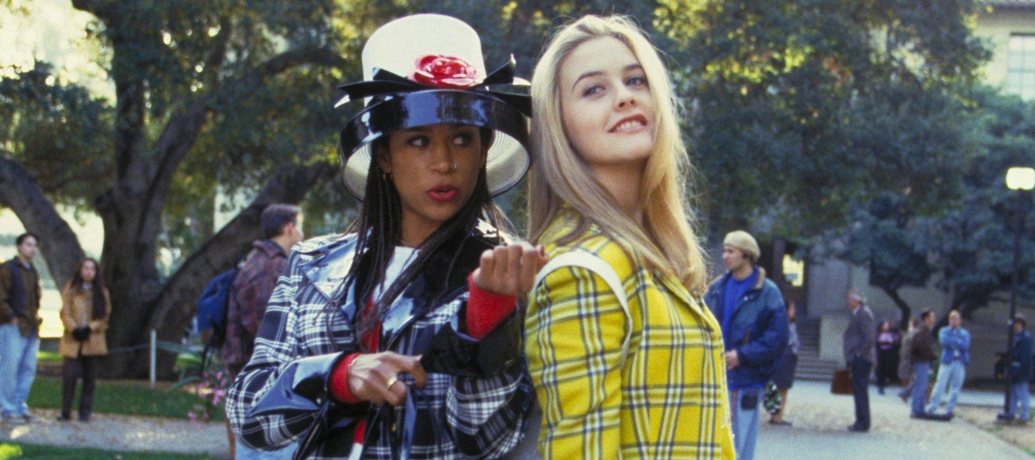 Cher and Dionne of Clueless stand back to back, a classic best friend duo.