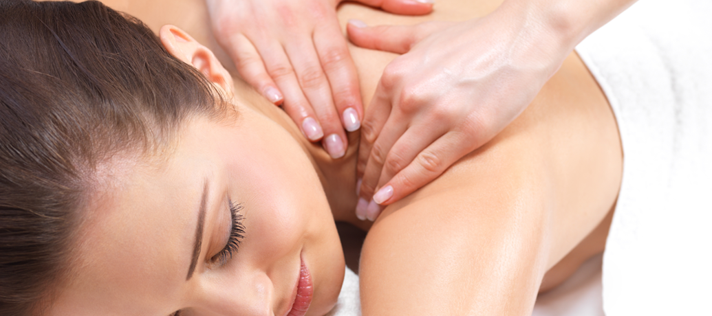 Woman experiences the relaxation and other benefits of an in-home massage with Zeel