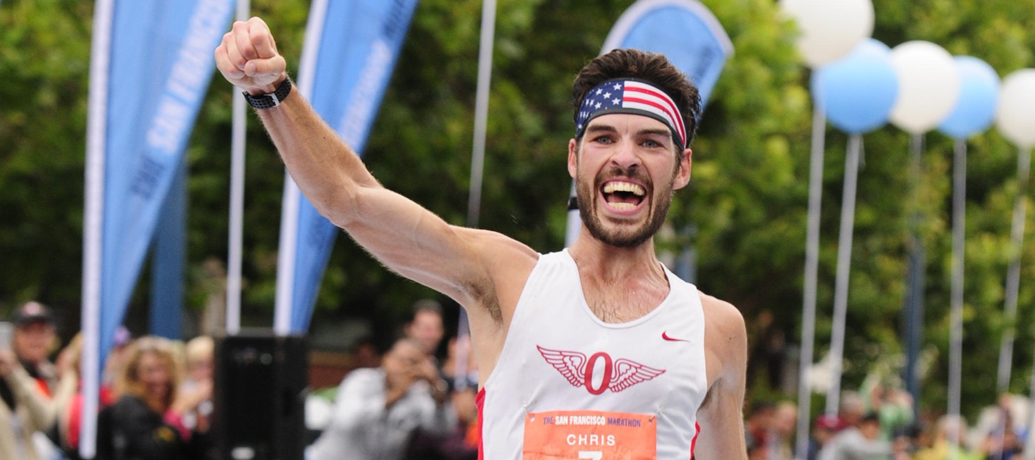 Chris Mocko cheers in excitement after winning the 2015 San Francisco Marathon