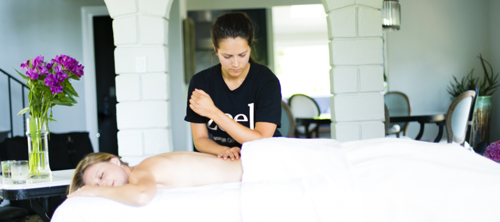 A Zeel Massage Therapist performs skilled work on a client during an in-home massage.