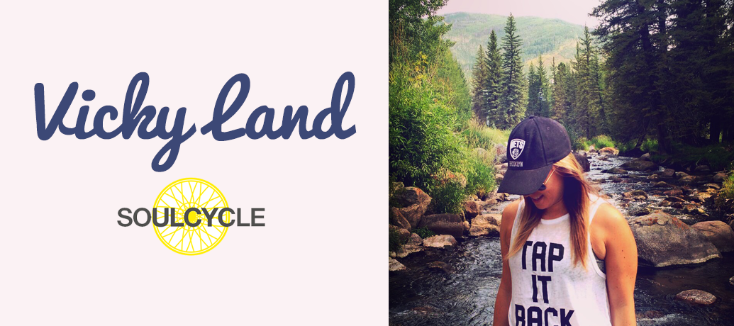 Vicky Land of SoulCycle poses against a beautiful forest backdrop for a mid-hike photo.