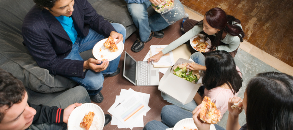 Co-workers gather together over an office-sponsored lunch on honor of Employee Appreciation Day