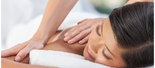 Woman enjoys a Zeel massage, aiding relaxation and weight loss.