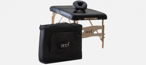 Zeel branded luxury massage table with headrest and embroidered carrying case