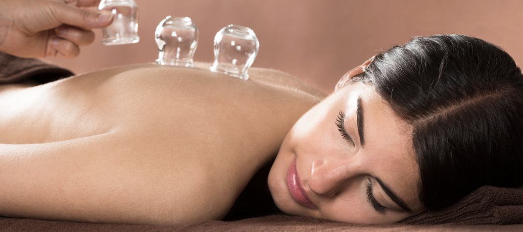 Woman lies peacefully during a cupping session.