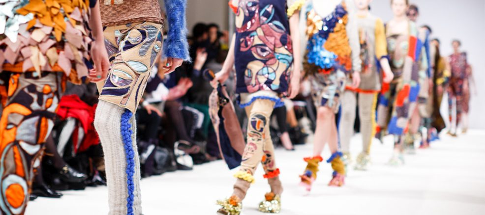 Models strut down the hallway in avante garde and couture looks during New York Fashion Week.