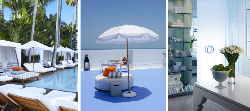 A chic line of poolside cabanas and tall green palm trees are the background to a row of white pool recliners, accented with tall white umbrellas and colorful pillows. An oversized ottoman is kept out of the sun by a tall white umbrella on a rooftop. A spa's cool blue interior is made serene by a bowl of bright green limes and a vase of white tulips.