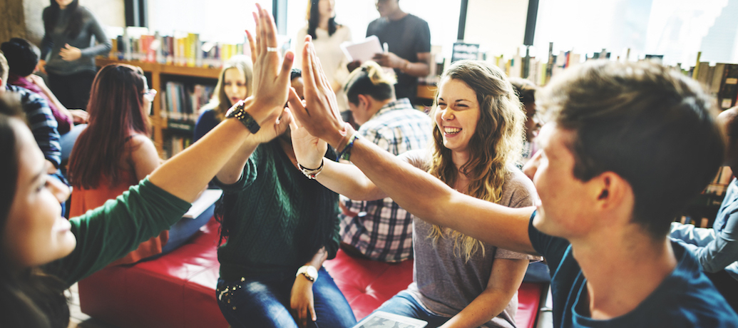Happy employees celebrating positive work culture