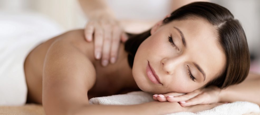 A mom relaxes peacefully during a Zeel in-home Mother's Day massage