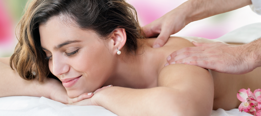 Woman getting lomi lomi massage