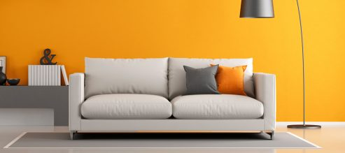 Orange room with couch and lamp