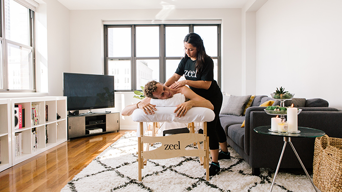 Man enjoying a Zeel in-home massage in his NYC apartment