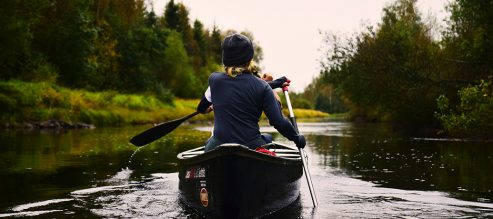 Woman kayaking outdoors