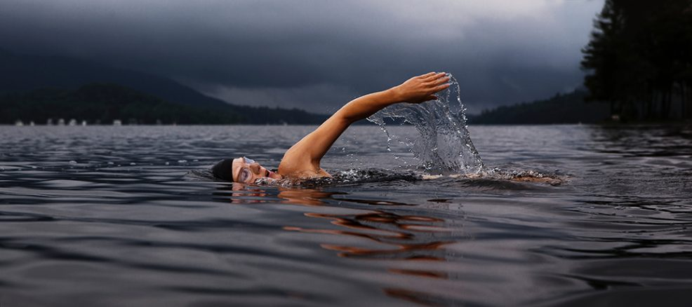 Swimmer works out in a lake