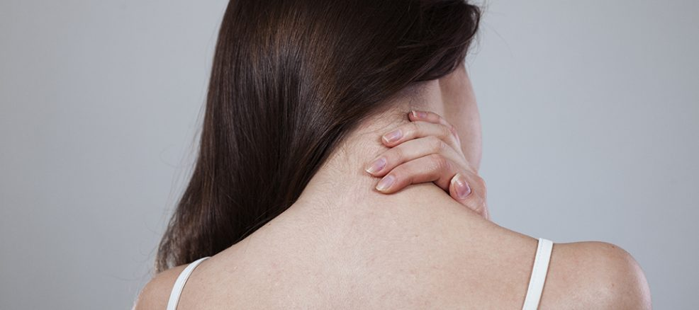 Woman With Neck And Shoulder Pain