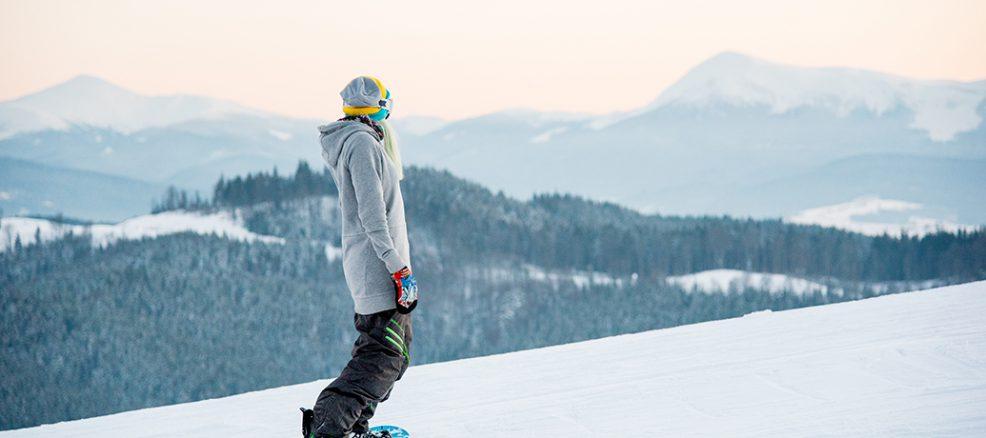 Woman snowboarding in winter