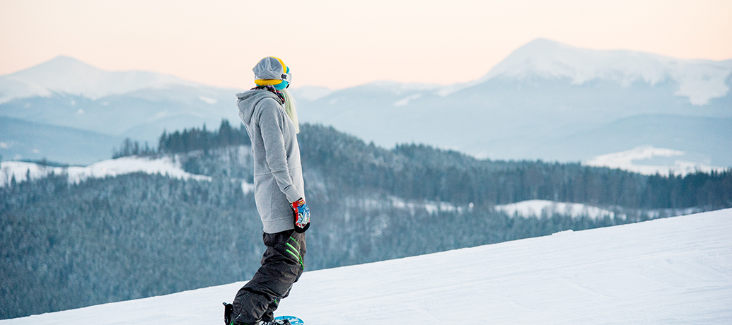 Woman snowboarding in winter